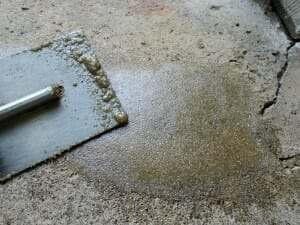 Epoxy sand slurry for repairing spalled garage floors