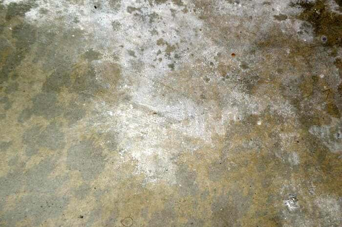 moisture on garage floor causes efflorescence