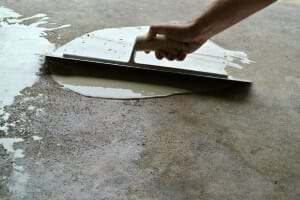 Repairing a pitted and spalled garage floor