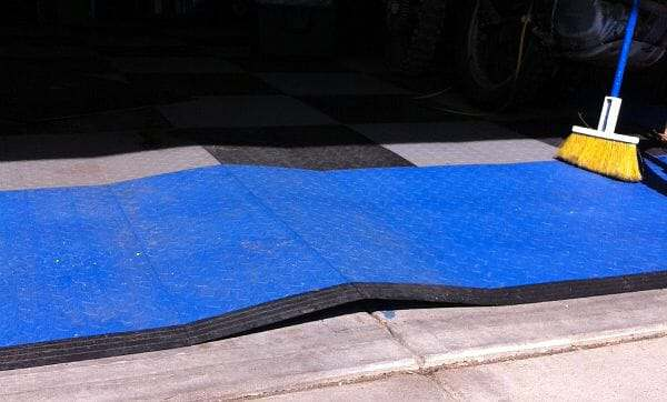 Interlocking garage floor tile buckling from exposure to sun