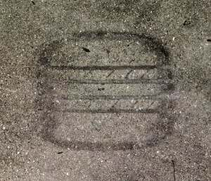 oil residue from tire in concrete causes hot tire lift