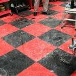 cleaning a dirty interlocking garage tile floor