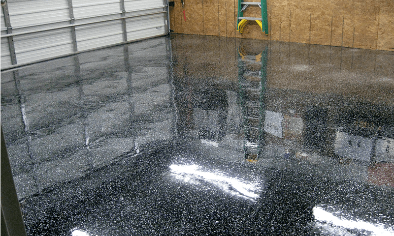 Epoxy clear coat on a black epoxy floor