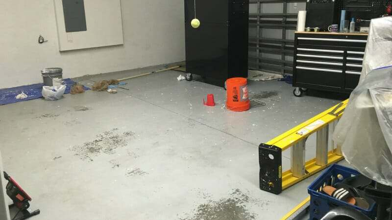 Old epoxy garage floor requires grinding for new coat