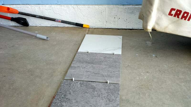 laying-out-porcelain-tile-garage